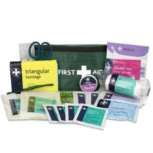 A bum bag first aid kit in green with the contents displayed