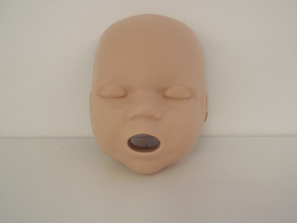 A replacement child manakin face