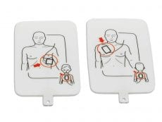 Apair of AED trainer pads with diagrams printed on them of where they should be placed.
